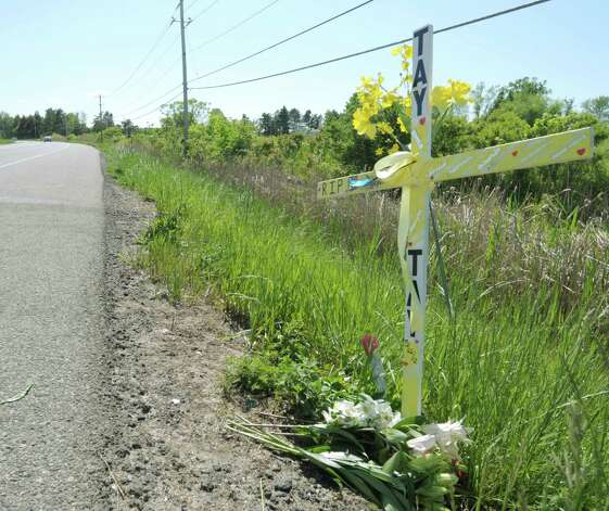 A cross was erected at the scene of a fatal vehicle accident on Wednesday, May 23, 2012, in Halfmoon, NY.  Taylor  Mosher, 19, died when her vehicle crossed the line on Route 146 and struck an oncoming vehicle Tuesday evening.  (Paul Buckowski / Times Union) Photo: Paul Buckowski