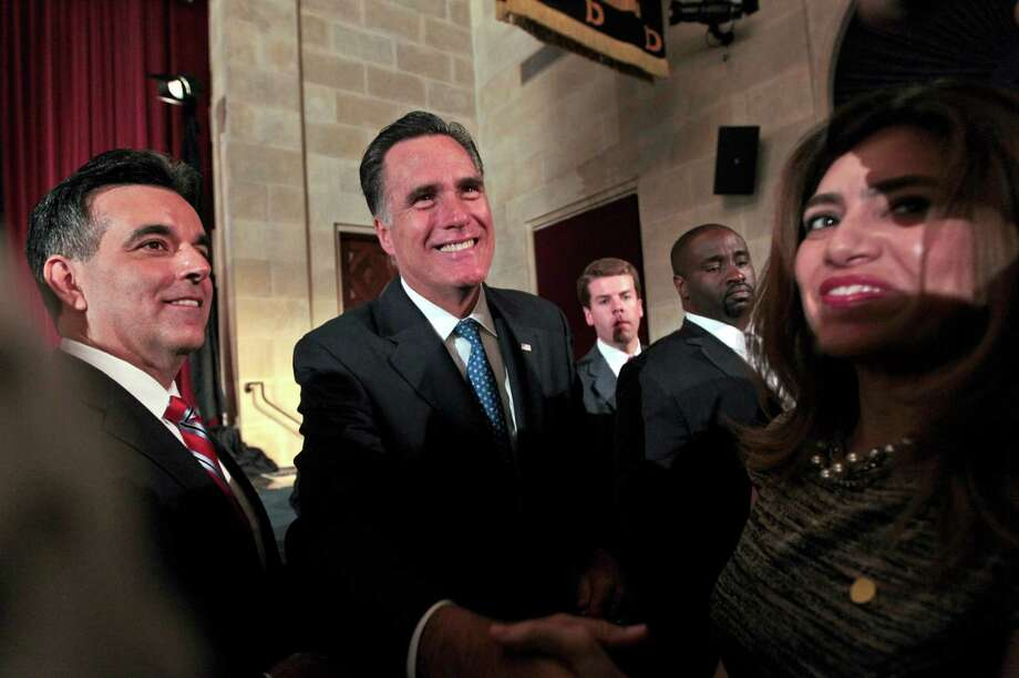 Republican presidential candidate Mitt Romney (center) is introduced to supporters by Latino Coalition Chairman Hector Barreto Jr. (left). Photo: Mary Altaffer, Associated Press