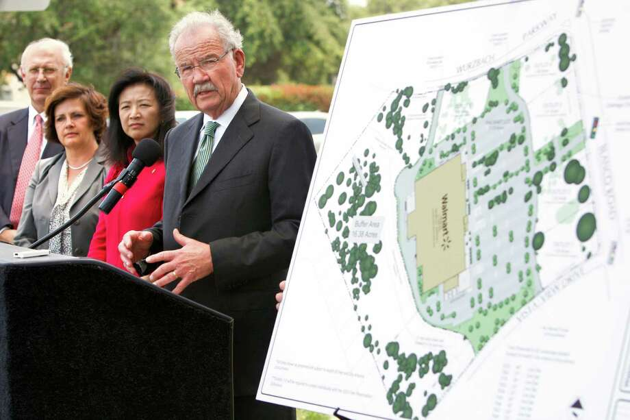 Former Mayor Phil Hardberger speaks about the deal for a new Wal-Mart at Blanco Road and Wurzbach Parkway on Wednesday, May 23, 2012. Nearby are landowner representative Doug Edwards (from left), Wal-Mart South Texas Regional General Manager Julie Martin and City Councilwoman Elisa Chan. Photo: William Luther, San Antonio Express-News / © 2012 WILLIAM LUTHER