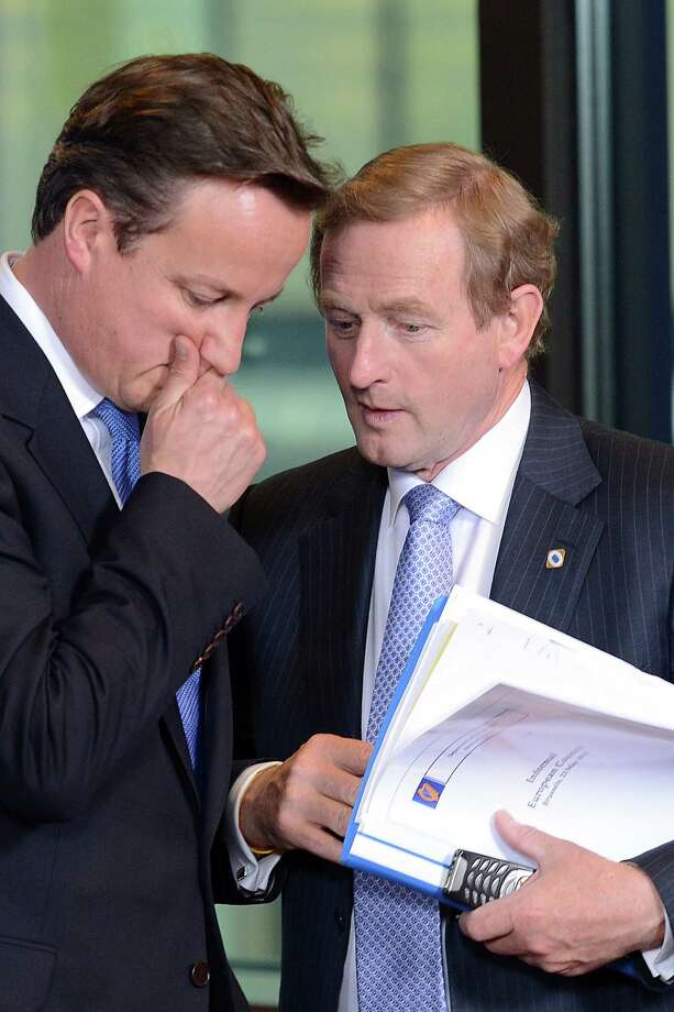 British Prime Minister David Cameron (left) and Irish Prime Minister Enda Kenny talk during the European Union summit at the EU Council in Brussels. Photo: Geert Vanden Wijngaert, Associated Press / AP
