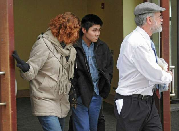 Ian Eckardt-Rigberg walks out of the Albany Judicial Center with his parents Chris, left, and Saul Rigverg Friday, March 2, 2012  in Albany, N.Y. A judge has set bail for the 19-year-old man charged with manslaughter after allegedly running down a pedestrian in Arbor Hill Saturday and then driving from the scene. (Lori Van Buren / Times Union) Photo: Lori Van Buren / 00016667A