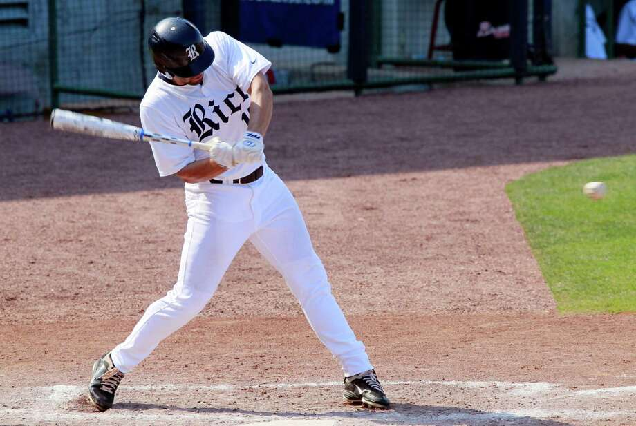 Rice's Michael Fuda begins his swing as he singles in the third inning against Houston during an NCAA college baseball game at the Conference USA tournament, Wednesday, May 23, 2012, in Pearl, Miss. (AP Photo/Rogelio V. Solis) Photo: Rogelio V. Solis, Associated Press / AP