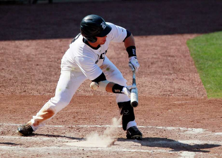 Rice's Michael Ratterree fouls a bunt attempt in the fourth inning against Houston during an NCAA college baseball game at the Conference USA tournament, Wednesday, May 23, 2012, in Pearl, Miss. (AP Photo/Rogelio V. Solis) Photo: Rogelio V. Solis, Associated Press / AP