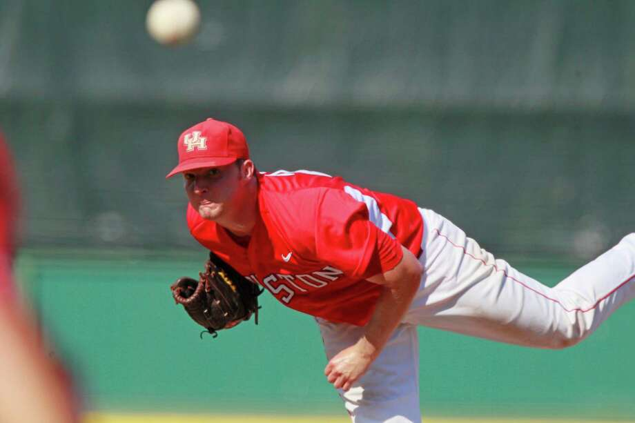Houston pitcher Jordan Lewis throws against against Rice during the fourth inning of an NCAA college baseball game at the Conference USA tournament, Wednesday, May 23, 2012, in Pearl, Miss. (AP Photo/Rogelio V. Solis) Photo: Rogelio V. Solis, Associated Press / AP