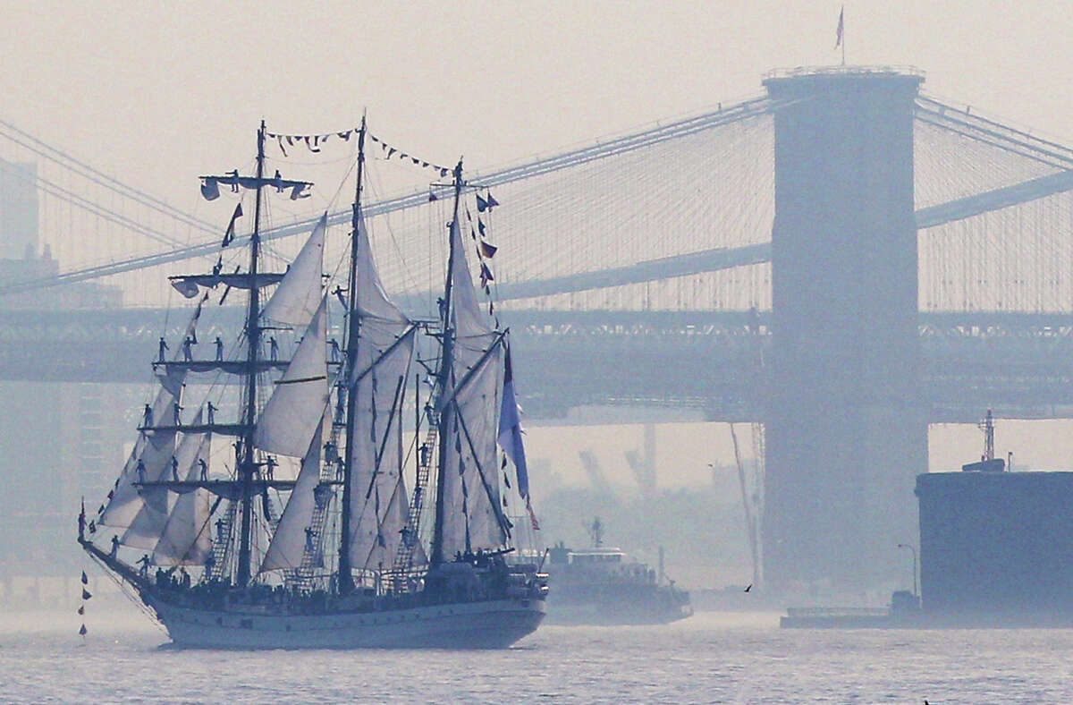 Tall ships travel up the Hudson River past New York City bridges as seen from Bayonne, N.J., Wednesday, May 23, 2012. Naval vessels ranging from a U.S. amphibious assault ship to a Finnish minelayer are participating in New York City's Fleet Week.