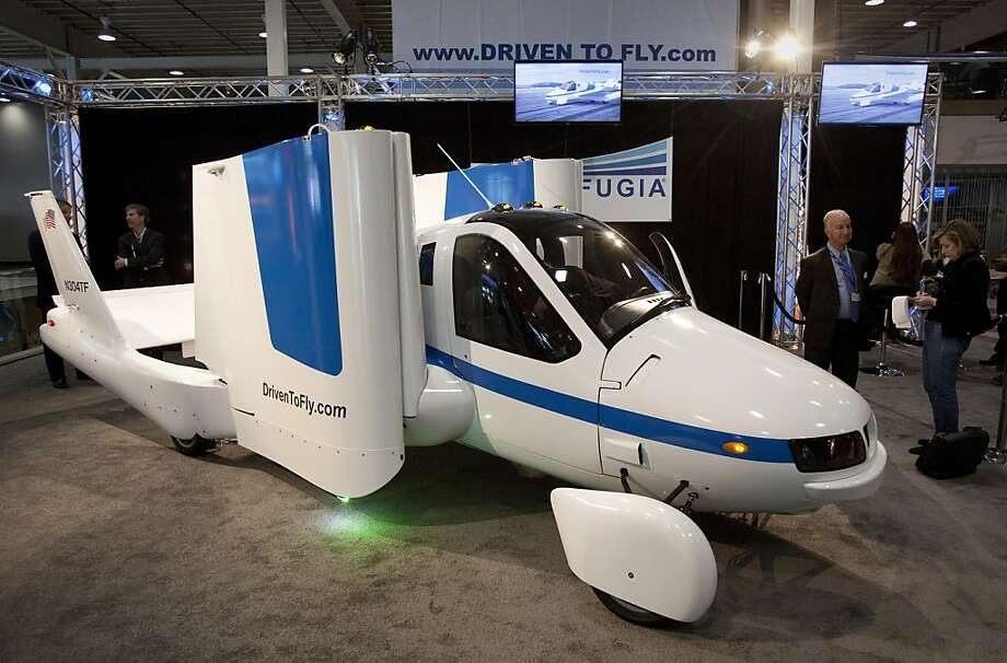 """The Terrafugia Transition """"flying car"""" sits on display at the New York International Auto Show in New York, U.S., on Wednesday, April 4, 2012. The Terrafugia Transition, developed by a group of Massachusetts Institute of Technology-trained engineers, seats two and can take off and land from more than 5,000 public U.S. airfields. It can be driven on any road and runs on the same gasoline as high-performance cars. Photographer: Scott Eells/Bloomberg Photo: Scott Eells, Bloomberg"""