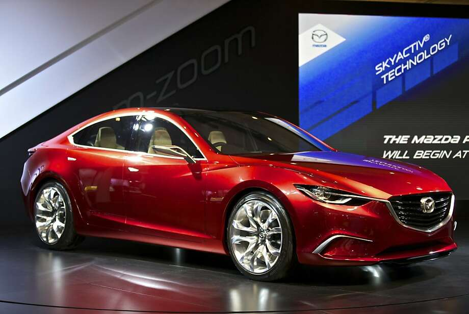 "The Mazda Takeri concept car on display at the New York International Auto Show in the Javits Convention Center, in New York, April 4, 2012. Unveiled last year at the Tokyo motor show, the Takeri is the near final draft of the Mazda 6 sedan and the latest expression of the company's recently introduced Kodo design language - defined as ""soul of motion"" and based on forms expressing coiled, potential power. (Benjamin Norman/The New York Times) Photo: Benjamin Norman, New York Times"