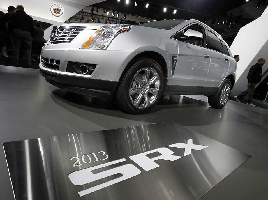 The 2013 Cadillac SRX is displayed at the New York International Auto Show, in New York's Javits Center,  Thursday, April 5, 2012. (AP Photo/Richard Drew) Photo: Richard Drew, Associated Press