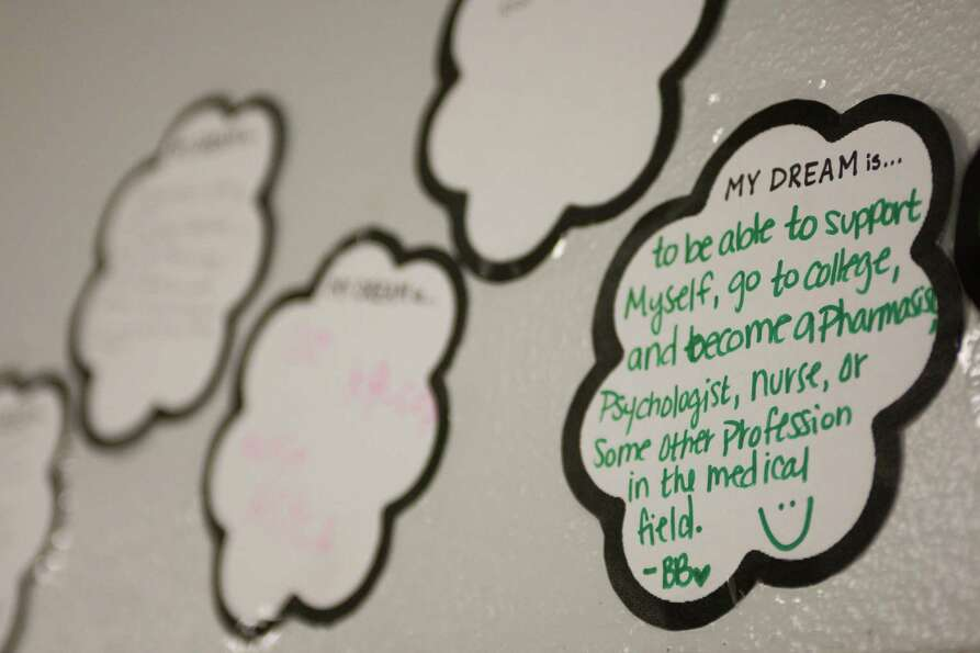 Messages of students' future ambitions hang on the walls of Hauke Alternative High School.