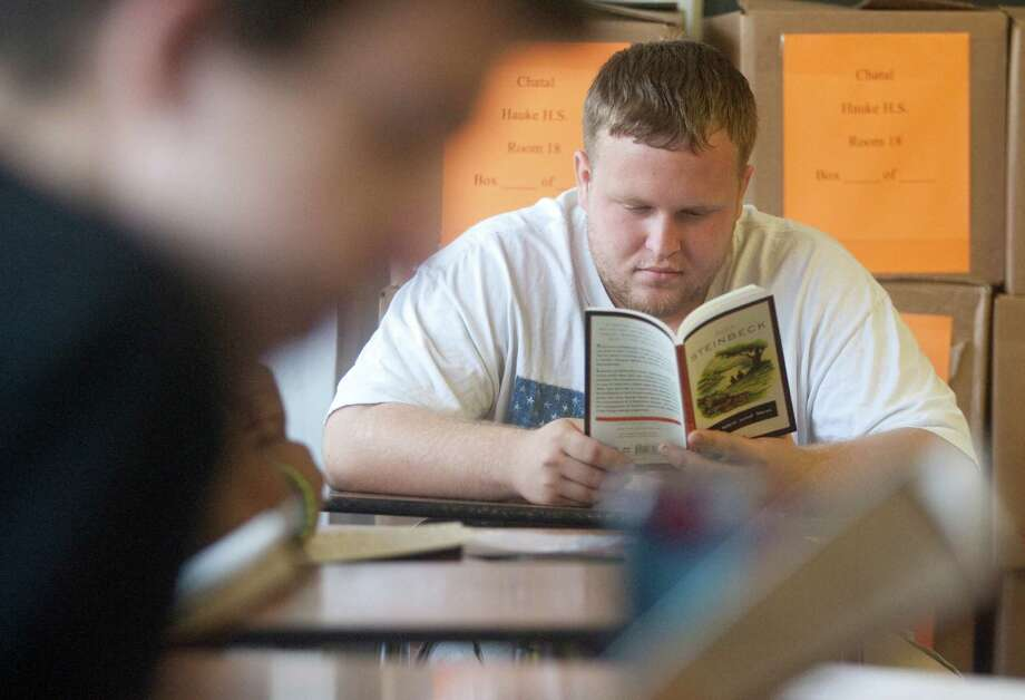 "Hauke Alternative High School student Caleb Beuck reads ""Of Mice and Men"" during class in Conroe, Texas.  Caleb plans to join the Navy upon graduation. Photo: J. Patric Schneider, For The Chronicle / Houston Chronicle"