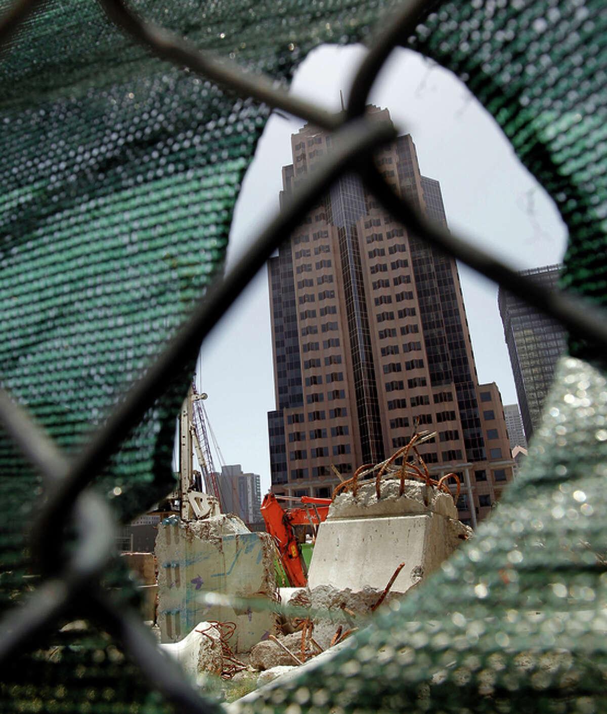Skyscrapers peek through construc tion at the Transbay Transit Center.