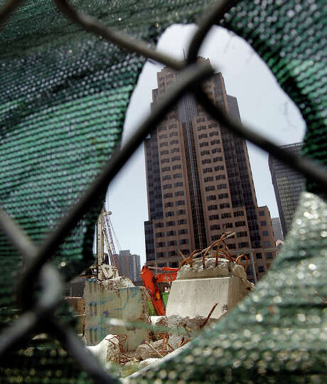 Skyscrapers peek through construc tion at the Transbay Transit Center. Photo: Michael Macor / The Chronicle / ONLINE_YES