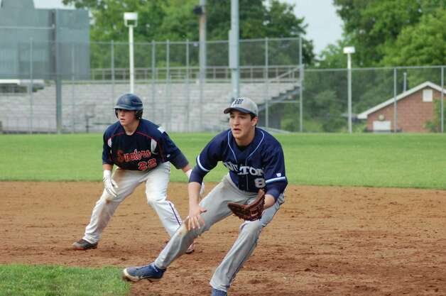 Brien McMahon's Alex Valenzano leads off first base behind Wilton's Ryan Reuther in the Senators' 4-1 win in the FCIAC baseball quarterfinals on Wednesday May 23, 2012 in Norwalk. Photo: Doug Bonjour