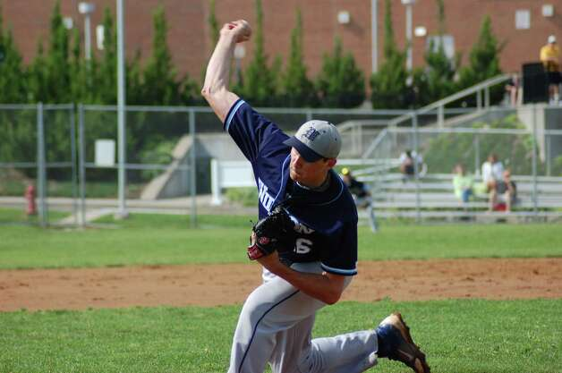 Wilton right-hander Paul Merolla pitches in a 4-1 loss to Brien McMahon in the FCIAC baseball quarterfinals on Wednesday May 23, 2012 in Norwalk. Photo: Doug Bonjour
