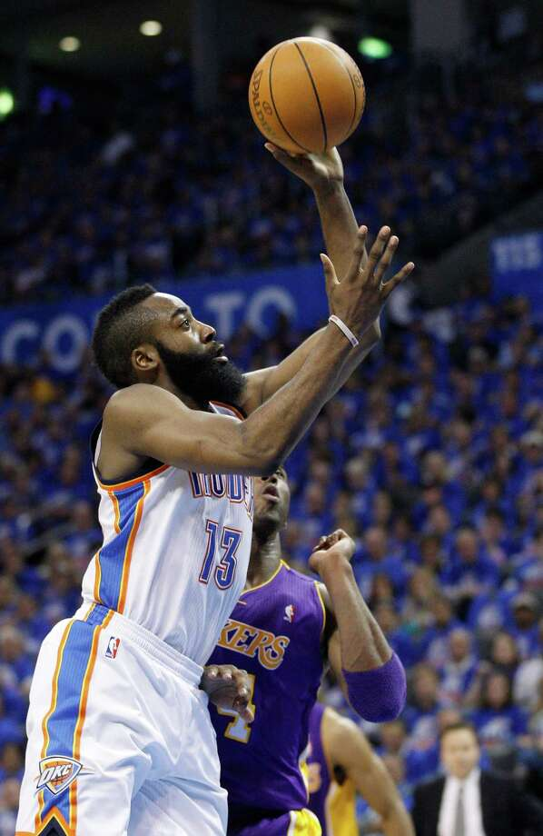 Thunder super sub James Harden (13), unlike the Spurs' Manu Ginobili, has been clicking in the playoffs. Photo: AP