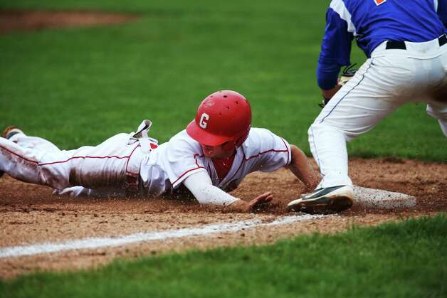 Greenwich High School's Dylan Callahan successfully steals third base during FCIAC baseball quarterfinals against Danbury High School on Wednesday May 23, 2012 in Greenwich, Conn. Greenwich won the game with a score of 6-5. Photo: Mike Ross / Greenwich Time