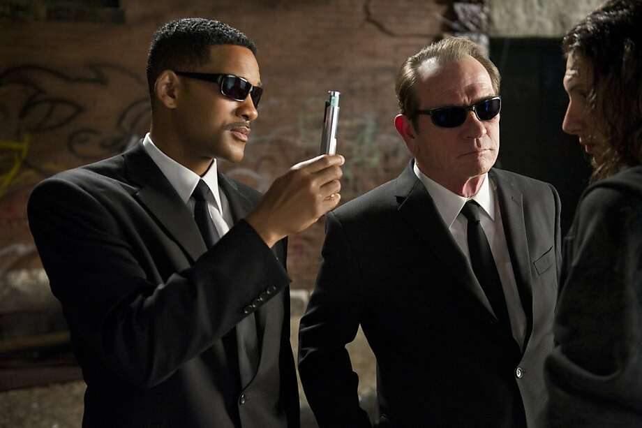 "In this film image released by Sony, Will Smith, left, and Tommy Lee Jones are shown in a scene from ""Men in Black 3."" (AP Photo/Sony Pictures, Wilson Webb) Photo: Wilson Webb, Associated Press"
