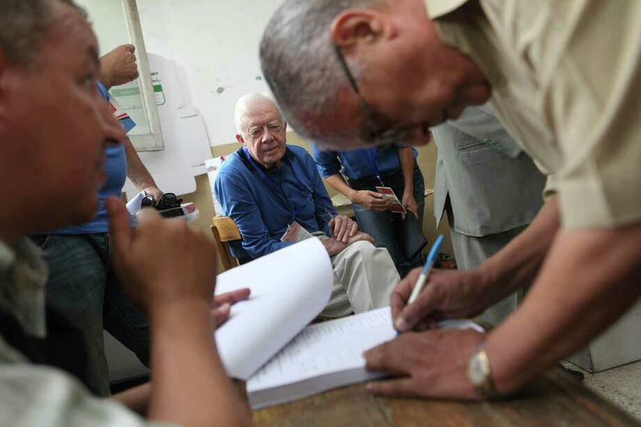 Former U.S. President Jimmy Carter, center, observes the election process inside a polling station in the Sayeda Aisha neighborhood of Cairo, Egypt, Wednesday, May 23, 2012.  The Carter Center is in Egypt to monitor the presidential elections. Photo: Thomas Hartwell, Associated Press / AP