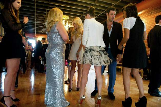 "Socializing as Maksim and Val Chmerkovskiy and Tony Dovolani, dancers on ABC's reality competition ""Dancing With the Stars,"" open Dance With Me Stamford, their fourth ballroom dance studio and their first in Connecticut, on Summer Street in Stamford, Conn., May 23, 2012. Photo: Keelin Daly / Stamford Advocate"