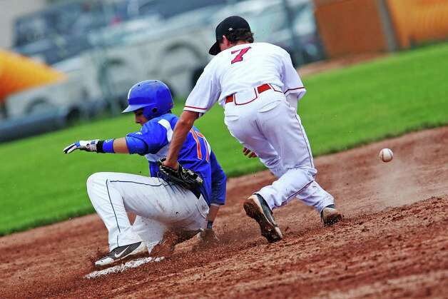 Danbury High School's Robert Bonacci safely slides into second base during a steal against Greenwich High School's Dylan Callahan in the FCIAC baseball quarterfinal game in Greenwich, Conn. on Wednesday May 23, 2012, Greenwich won the game 6-5. Photo: Mike Ross / Greenwich Time freelance