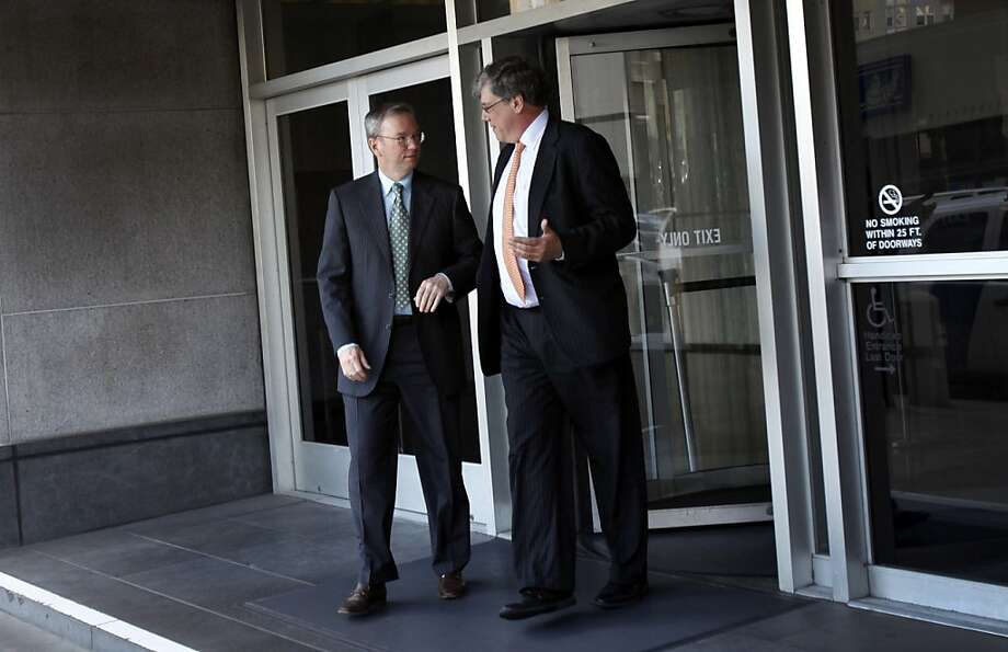 Google Executive Chairman Eric Schmidt, left, leaves federal court after testifying in the federal court case alleging that Google stole Oracle's intellectual property when developing its popular Android mobile operating system in San Francisco, Calif., Tuesday, April 24, 2012. Photo: Sarah Rice, Special To The Chronicle