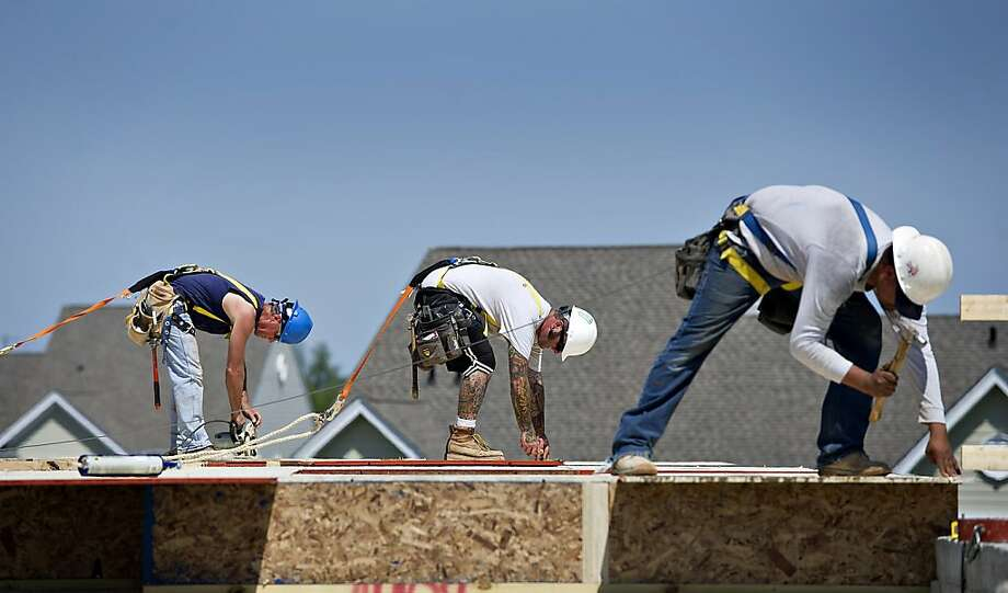 Framing carpenters work on a Toll Bros. Inc. town home under construction in Elgin, Ill., in 2012. Photo: Daniel Acker, Bloomberg