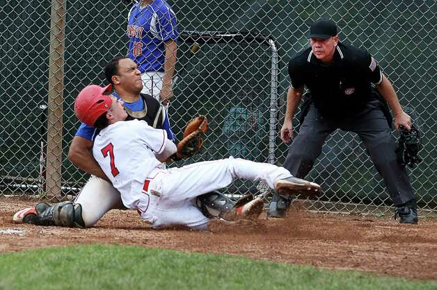 Greenwich High School's Dylan Callahan collides with Danbury catcher Austin Calitro while stealing home plate. Callahan was safe on the play. Greenwich defeated Danbury in FCIAC baseball quarterfinals on Wednesday, May 23, 2012 in Greenwich, Conn. Photo: Mike Ross / Greenwich Time