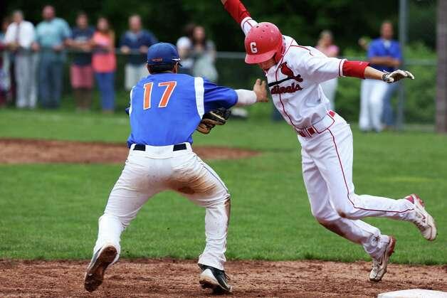 Greenwich High School's David Berdoff attempts to avoid the tag of Danbury's third baseman Robert Bonacci in the FCIAC baseball quarterfinals in Greenwich, Conn. on Wednesday, May 23, 2012. Berdoff was out on the play. Greenwich won the game 6-5. Photo: Mike Ross / Greenwich Time