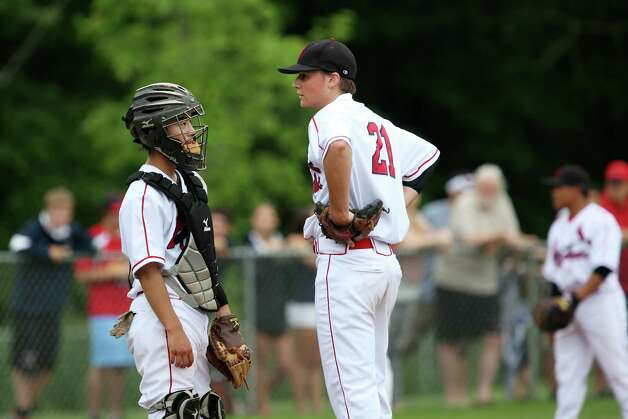 Greenwich High School pitcher Casey Gaynor and catcher Ricky Okazaki chat on the mound during the FCIAC baseball quarterfinals against Danbury on Wednesday, May 23, 2012. Greenwich won with a score of 6-5. Photo: Mike Ross / Greenwich Time