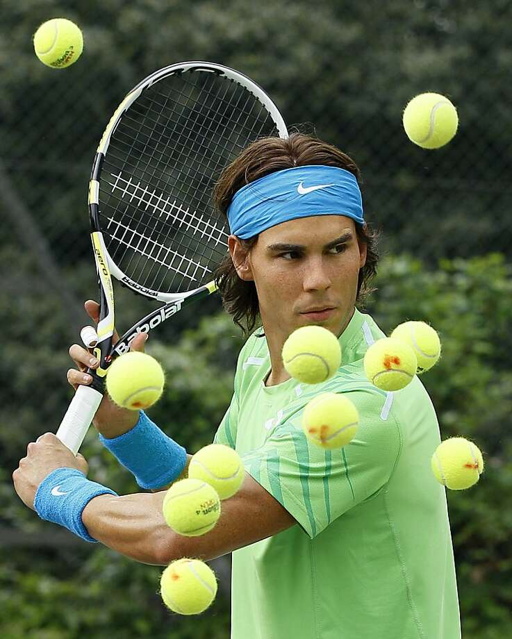 Why are there so many balls for Raffy to hit? And why are some bloodstained?Astute readers may notice this is not the real Rafael Nadal but rather a wax double at the tennis center in London's Regents Park. Photo: Kirsty Wigglesworth, Associated Press
