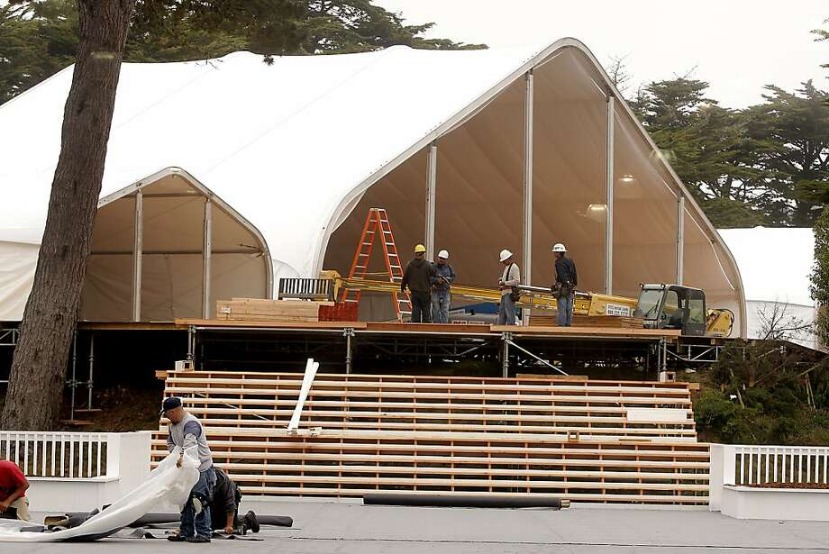 Construction workers build new temporary buildings and transform the Olympic Club in advance of next month's U.S. Open in San Francisco, Calif. on May 21, 2012. Photo: Siana Hristova, The Chronicle