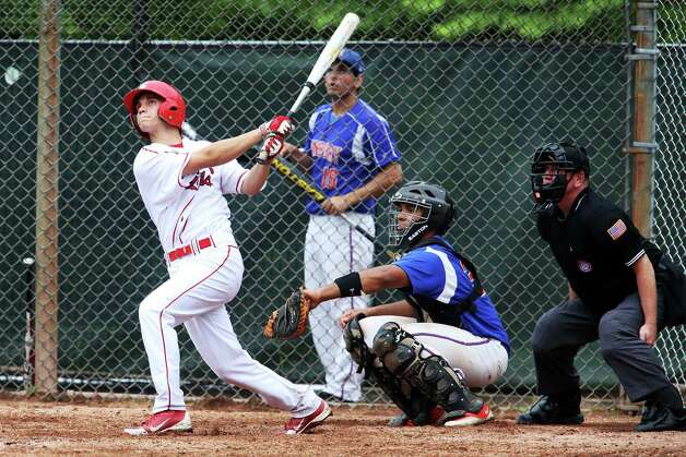 Greenwich High School's Nick Bancroft hits a double into center field during the FCIAC baseball quarterfinal game against Danbury High School on Wednesday, May 23, 2012. Greenwich won the game 6-5. Photo: Mike Ross / Greenwich Time freelance