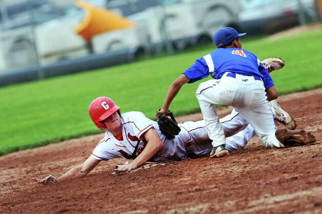 Greenwich High School's Kyle Dunster slides safely into second base past Danbury's Marquise Marrero in the FCIAC baseball quarterfinals in Greenwich, Conn. on Wednesday May 23, 2012. Greenwich won 6-5. Photo: Mike Ross / Greenwich Time freelance