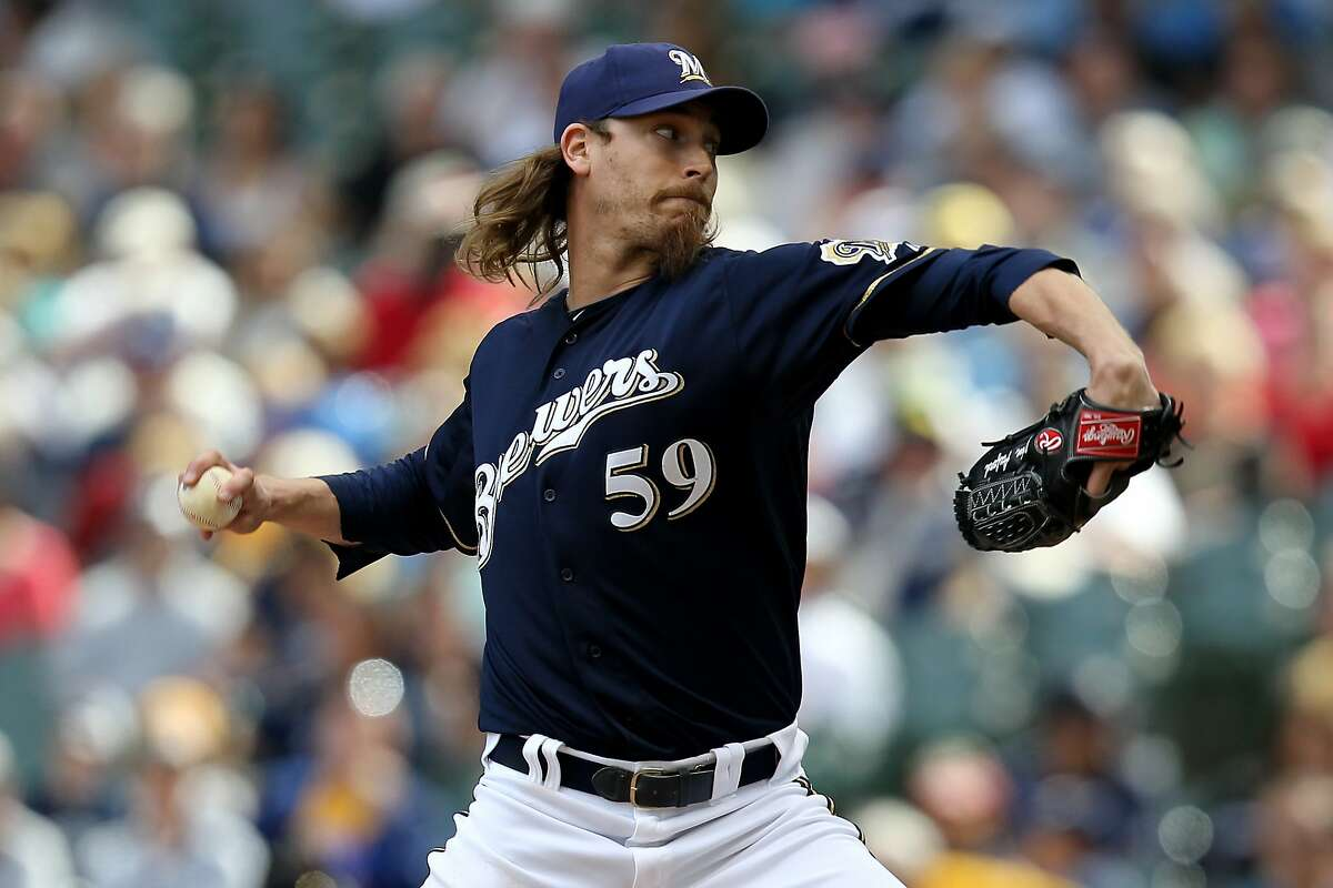 MILWAUKEE, WI - MAY 23: John Axford #59 of the Milwaukee Brewers pitches in the 9th inning against the San Francisco Giants during the game at Miller Park on May 23, 2012 in Milwaukee, Wisconsin. (Photo by Mike McGinnis/Getty Images)