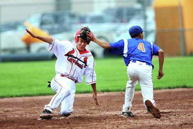 Greenwich High School pinch runner Ryota Fujikara steals second base in the FCIAC baseball quarterfinals against Danbury's Marquise Marrero on Wednsday May 23, 2012. Greenwich won the game 6-5 and advance to the finals. Photo: Mike Ross / Greenwich Time Freelance