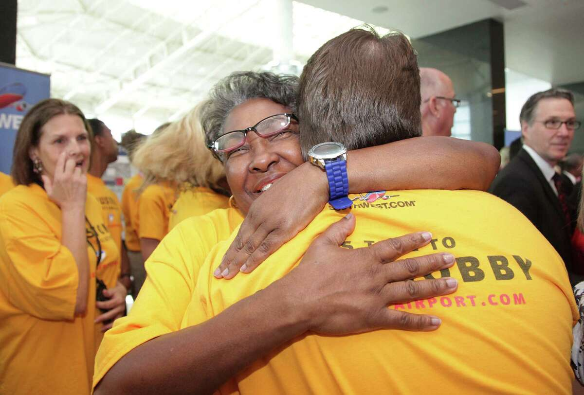 Shirley Griffin and other Southwest Airlines employees celebrate after a news conference at Hobby Airport on Wednesday.