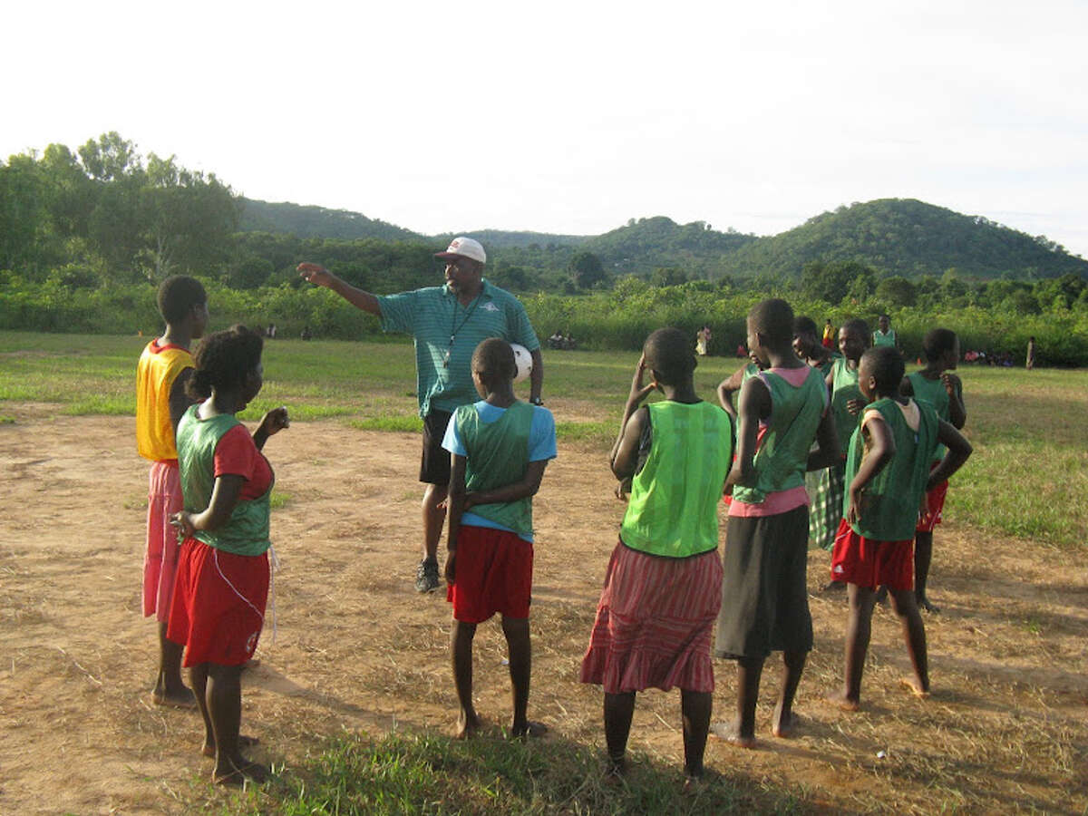 COACH BANDA, INSTRUCTING THE GIRLS SOCCER TEAM FROM MALENGA MZOMA PRIMARY SCHOOL IN CHITUKA VILLAGE
