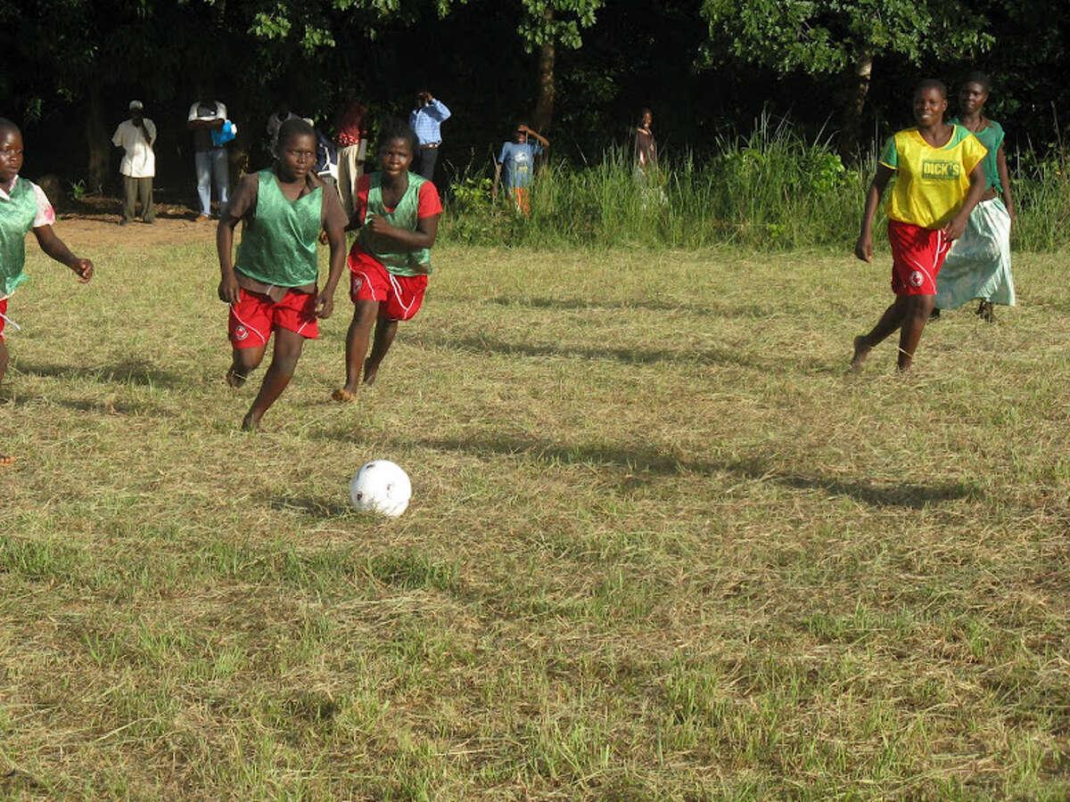 Girls playing soccer in the village of Chituka. (Courtesy of Kalekeni Banda)