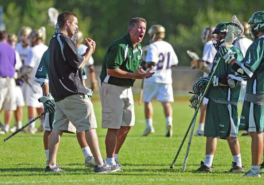 Shen coach Chuck Holohan, center, urges on his team during their 11-10 overtime victory over CBA in a Section II Class A semifinal, on Wednesday May 23, 2012 in Colonie, NY.   (Philip Kamrass / Times Union ) Photo: Philip Kamrass / 00017778A