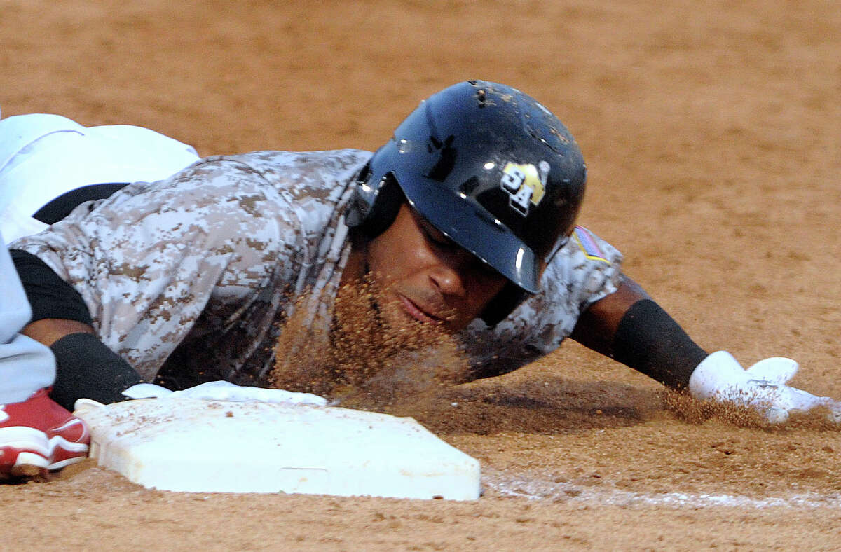 San Antonio's Jonathan Galvez slides into first base on a pickoff attempt during Texas League action against Springfield at Wolff Stadium on Wednesday, May 23, 2012.