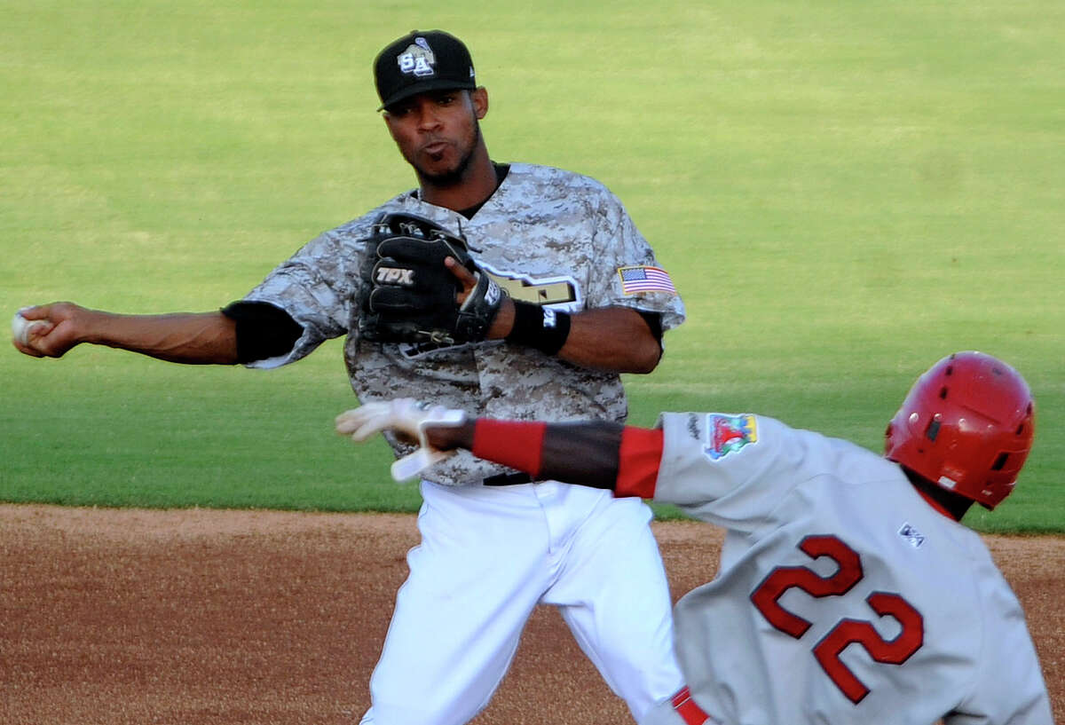 San Antonio Missions shortstop Jeudy Valdez turns a double play as Jermaine Curtis of the Springfield Cardinals slides in during Texas League baseball action at Wolff Stadium on Wednesday, May 23, 2012.