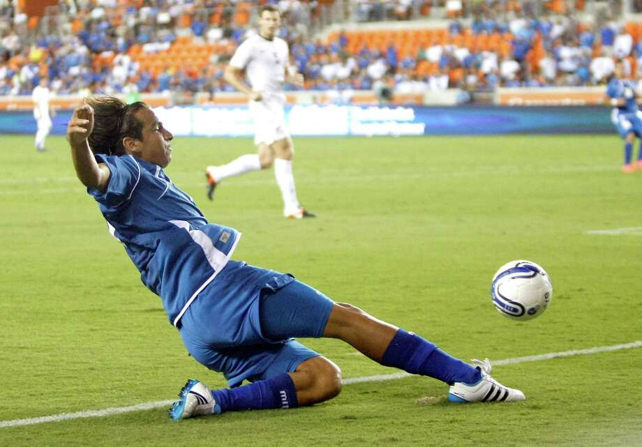 Rafael Edgardo Burgos takes a shot at the goal during the first half of an international friendly game against New Zealand, Wednesday, May 23, 2012, in BBVA Compass Stadium in Houston. Photo: Nick De La Torre, Houston Chronicle / © 2012  Houston Chronicle