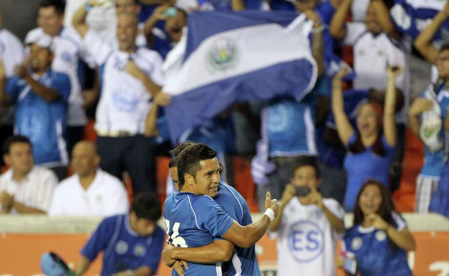 Jaime Enrique, of El Salvador, facing, hugs his teammate Rafael Edgardo Burgos after Burgos scored a goal during the thirteenth minute of the first half half of an international friendly game against New Zealand, Wednesday, May 23, 2012, in BBVA Compass Stadium in Houston. Photo: Nick De La Torre, Houston Chronicle / © 2012  Houston Chronicle