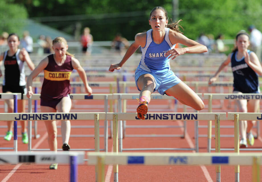 Shaker senior Emma Torncello, 18, leads the pack and wins the 100 meter hurdles during the Section II girls track meet Wednesday, May 23, 2012 in Johnstown, N.Y. (Lori Van Buren / Times Union) Photo: Lori Van Buren