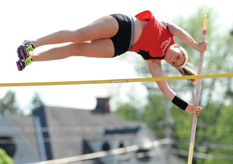 Guilderland junior Jaclyn Levy, 17, clears the 9'  high bar in the pole vault during the Section II