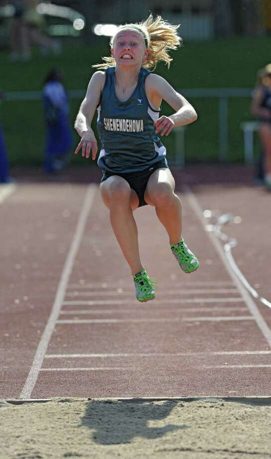 Shenendehowa freshman Katie Benson, 14, competes in the long jump during the Section II girls track meet Wednesday, May 23, 2012 in Johnstown, N.Y. (Lori Van Buren / Times Union) Photo: Lori Van Buren