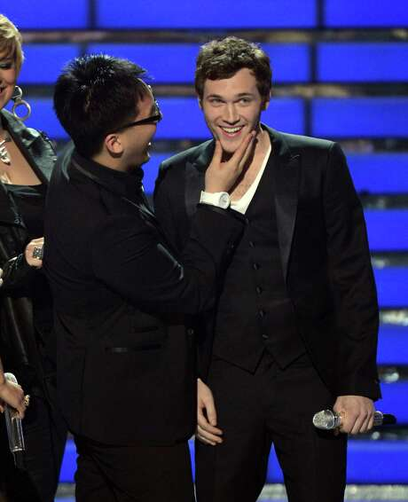 """Singer Heejun Han, left, congratulates Phillip Phillips on Wednesday after Phillips was chosen as the 11th winner during """"American Idol."""" Photo: Mark Davis / 2012 Getty Images"""