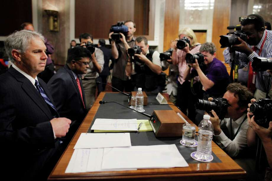 U.S. Secret Service Director Mark Sullivan,left, and  Department of Homeland Security's acting Inspector General Charles K. Edwards, prepare to testify on Capitol Hill in Washington, Wednesday, May 23, 201, before the Senate Homeland Security and Governmental Affairs Committee. (AP Photo/Charles Dharapak) Photo: Charles Dharapak