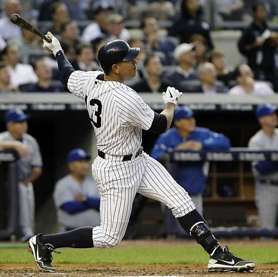 New York Yankees' Alex Rodriguez (13) follows through on his third-inning, solo home run during their baseball game against the Kansas City Royals at Yankee Stadium in New York, Wednesday, May 23, 2012. (AP Photo/Kathy Willens) Photo: Kathy Willens, Associated Press