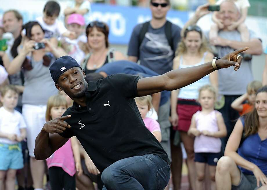 Jamaican sprinter Usain Bolt poses during a promotional event with children on May 23, 2012 prior to the Zlata Tretra (Golden Spike) athletics meeting in the eastern Czech city of Ostrava.    AFP PHOTO/ ROBERT MICHAELROBERT MICHAEL/AFP/GettyImages Photo: Robert Michael, AFP/Getty Images